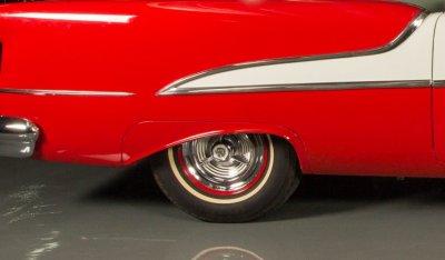 Oldsmobile 88 1956 rear wheel closeup view